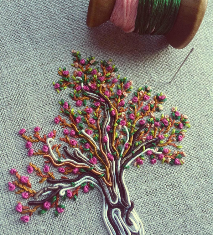 小巧的树枝上开满了云霞似的花朵.